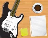 Paginación, escritorio y guitarra Imágenes de archivo libres de regalías