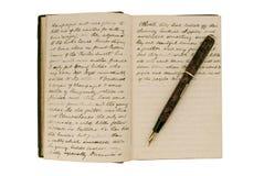 Paginaciones en un diario antiguo del recorrido foto de archivo