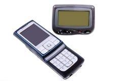 Paginador y teléfono celular sin hilos. Foto de archivo
