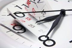 Pagine ed orologio del calendario Fotografie Stock