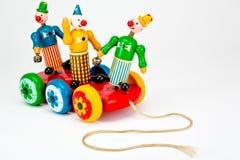 Pagliacci su un giocattolo di tiro. Fotografia Stock