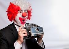 Pagliaccio della macchina fotografica istante Immagine Stock