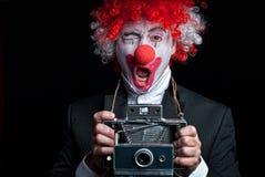 Pagliaccio della macchina fotografica istante divertente Fotografie Stock Libere da Diritti