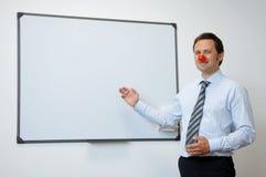 Pagliaccio di affari con il naso rosso Fotografie Stock Libere da Diritti