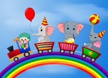 Pagliaccio ed elefante sul treno con l'illustrazione dell'arcobaleno Immagini Stock Libere da Diritti