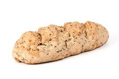 Pagnotta del grano intero di pane casalinga su bianco Fotografia Stock Libera da Diritti