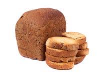 Pagnotta di pane con le fette biscottate Immagini Stock Libere da Diritti
