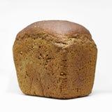 Pagnotta di pane nero su un fondo bianco Fotografie Stock Libere da Diritti
