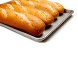 Pagnotte di pane francese su uno strato di cottura Immagini Stock Libere da Diritti