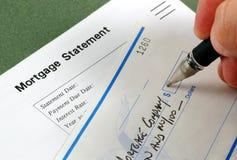 Pago de hipoteca Imágenes de archivo libres de regalías