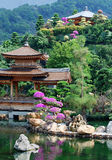 Pagoda of Asian temple and pond Stock Photo