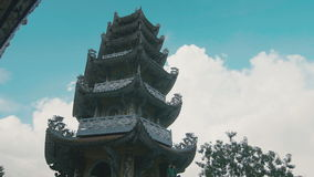 Pagoda on a background of the sky with clouds stock footage