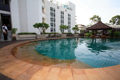 Pagoda, bar at the swimming pool, sun loungers next to the garden and buildings. Swimming pool at the hotel at the resort. The buildings, sun chairs, nice view Royalty Free Stock Photo