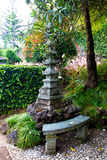 Pagoda and  bench in a Japanese garden Stock Photography