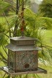 Pagoda Bird Feeder and Pine Needles Royalty Free Stock Images