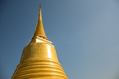 Pagoda on blue background. The Golden Pagoda in Thailand Temple Royalty Free Stock Image
