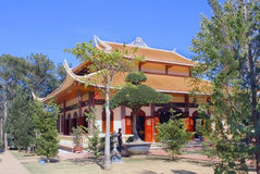 Pagoda in buddist monastery Long Shon. Pagoda among the trees in a Buddhist monastery Long Shon Stock Image