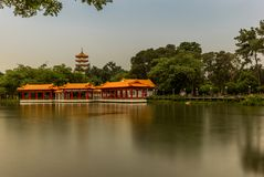 Pagoda and column terrasse reflecting in the the lake in the Chi. Chinese marble bridge temples reflecting in the lake in the Chinese garden in Singapore Stock Image