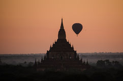 Pagoda at dawn. One of Bagan's pagodas in the morning with balloon on the sky Stock Image