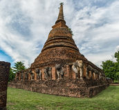 Pagoda with elephant sculptures surrounded. In Sukhothai Royalty Free Stock Photo