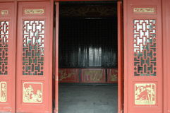 Pagoda entrance. Traditional Chinese architecture - entrance to pagoda, wooden door painted in red color with some simple decoration Royalty Free Stock Images
