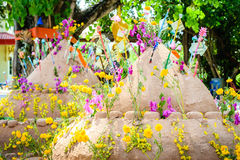 Pagoda and flower on sand in Songkran day festival , Thailand. Prayer flags , pagoda and flower on sand in Songkran day festival , Thailand royalty free stock photos