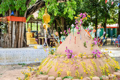 Pagoda and flower on sand in Songkran day festival , Thailand. Prayer flags , pagoda and flower on sand in Songkran day festival , Thailand stock photography