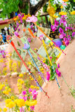 Pagoda and flower on sand in Songkran day festival , Thailand. Prayer flags , pagoda and flower on sand in Songkran day festival , Thailand royalty free stock image
