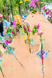 Pagoda and flower on sand in Songkran day festival , Thailand. Prayer flags , pagoda and flower on sand in Songkran day festival , Thailand royalty free stock photo