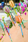 Pagoda and flower on sand in Songkran day festival , Thailand. Prayer flags , pagoda and flower on sand in Songkran day festival , Thailand royalty free stock images