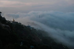 Pagoda and fog. Flowing of the fod through the vally of Myanmar mountain Stock Photo
