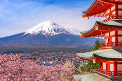 Pagoda and Fuji in Spring. Fujiyoshida, Japan at Chureito Pagoda and Mt. Fuji in the spring with cherry blossoms Stock Photos