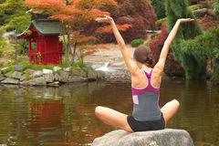Woman Arms Outstretched Rock Pagoda Pond Stock Images