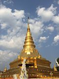 Pagoda. Golden pagoda on blue sky Stock Images
