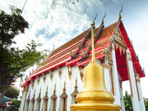 The pagoda is beside the golden church,Wat Nakhon Sawan,Thailand Royalty Free Stock Photo