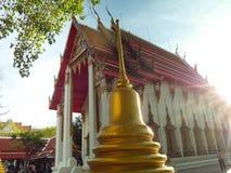 The pagoda is beside the golden church,Wat Nakhon Sawan,Thailand stock photo