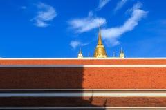 Pagoda of the Golden Mountain on blue sky background at Thai tem Stock Photos