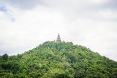 Pagoda on hill. Unfinished pagoda on hill with sky and cloud scene Royalty Free Stock Images