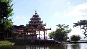 Pagoda on the lake shore. Temple near the water. Old church stock video footage