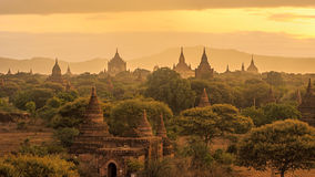 Pagoda landscape under a warm sunrise in the plain of Bagan, Mya Stock Images