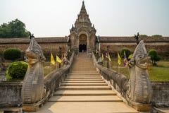 Pagoda at the main entrance of Wat Prathat Lampang Luang, an ancient Buddhist temple. Pagoda at the main entrance of Wat Prathat Lampang Luang, an ancient royalty free stock photo