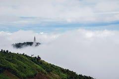 Pagoda on Mount, Fog shrouded the mountaintop Stock Photo