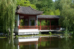 Pagoda near the water. The Chinese pagoda near the water. Summer landscape Stock Images