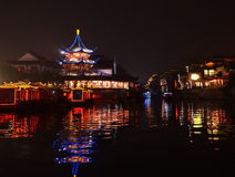 Pagoda outlined in light by the water Stock Images