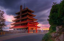 Pagoda Overlooking City of Reading, PA at Sunset. Sitting atop Mt. Penn with a commanding view of the city of Reading, Pennsylvania, the Pagoda is a long stock photography
