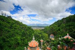 Pagoda Red Roofs among Hill Tropics by Lake in Vietnam Stock Photos