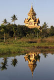 Pagoda reflected in the water, Bago, Burma Stock Image