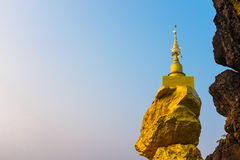 Pagoda on rock stone with blue sky Stock Image
