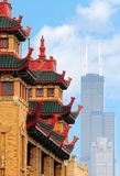 Pagoda and Skyscraper. A pagoda-like building in Chicago's Chinatown with the city's tallest building in the background Royalty Free Stock Image