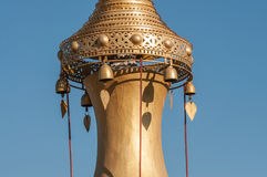 Pagoda spire. Detail of a gold stupa spire with jingles in Shwe Indein near Inle lake in Myanmar Stock Photo